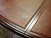кожаный бювар на столе