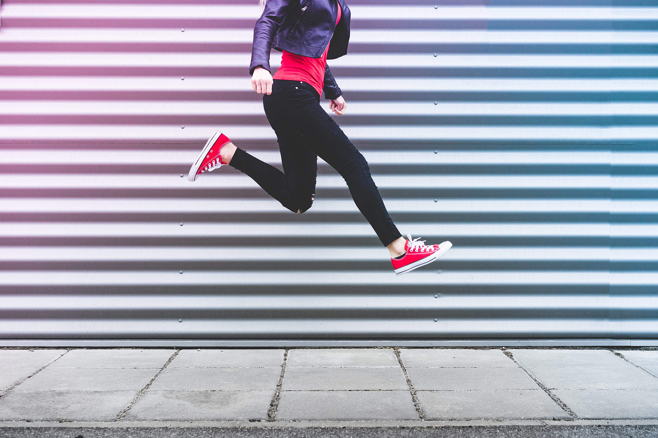 young-happy-woman-jumping-in-front-of-metal-wall_free_stock_photos_picjumbo_DSC03703-2210x1474.jpg