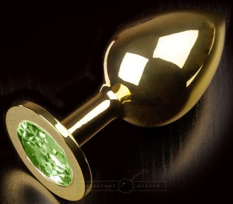Золотистая анальная пробка с салатовым кристаллом - 9 см.