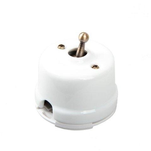 Выключатель тумблерный одноклавишный проходной, для наружного монтажа. Цвет Белый. Salvador. OP41WT
