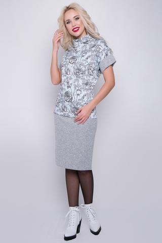"""<p>Трикотажный костюм в пастельных тонах. Состоит из блузки оригинального кроя, ворот """"качели"""", рукав спущенный на манжете и юбки на резинке. (Длины блуза/юбка: 46=63/63см; 48=64/63см; 50=65/64см; 52=66/64см)&nbsp;</p>"""