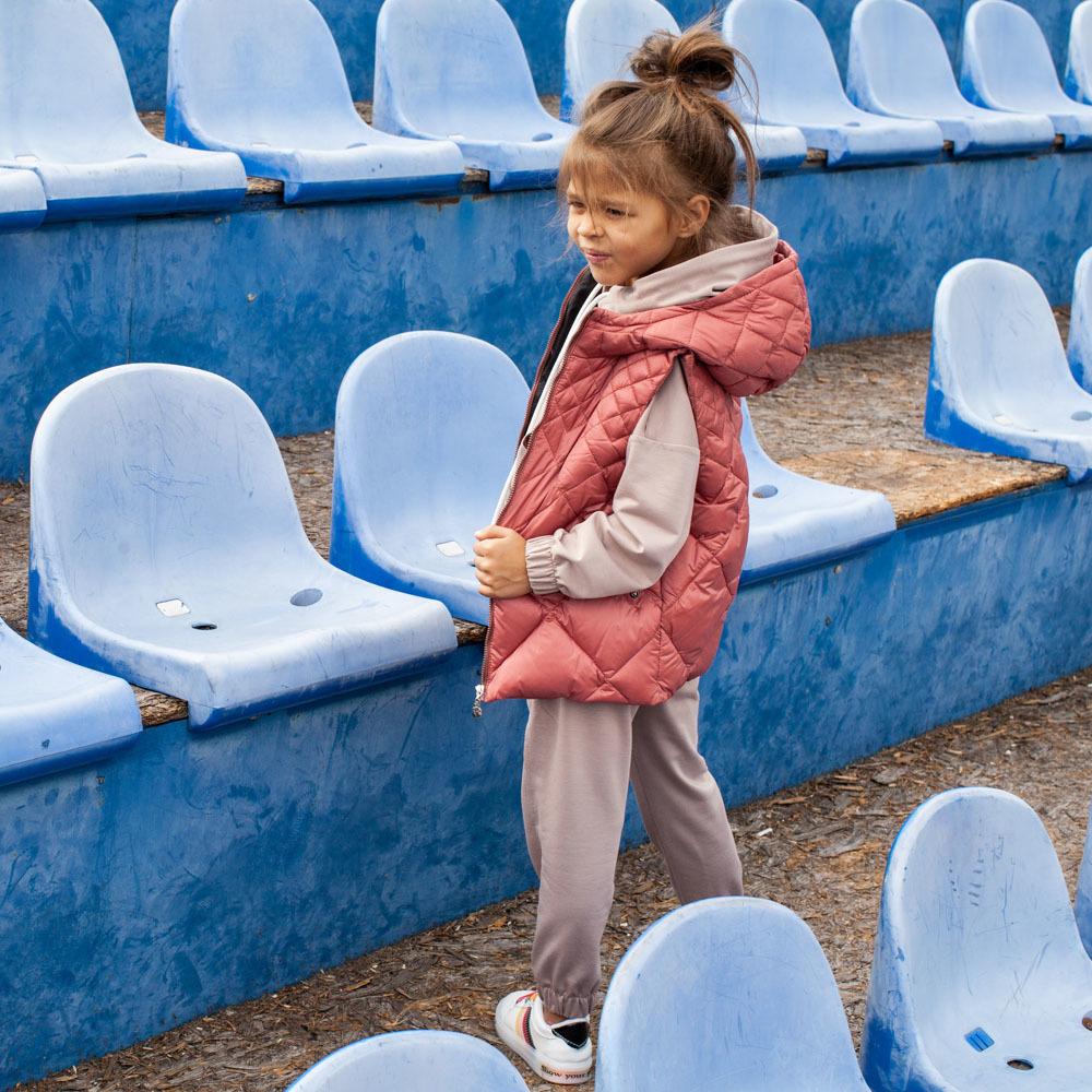 Детский стеганный жилет унисекс на девочку