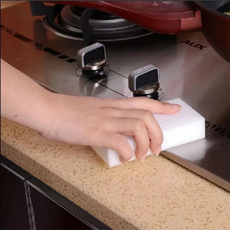 Меламиновая губка-ластик для удаления пятен фото