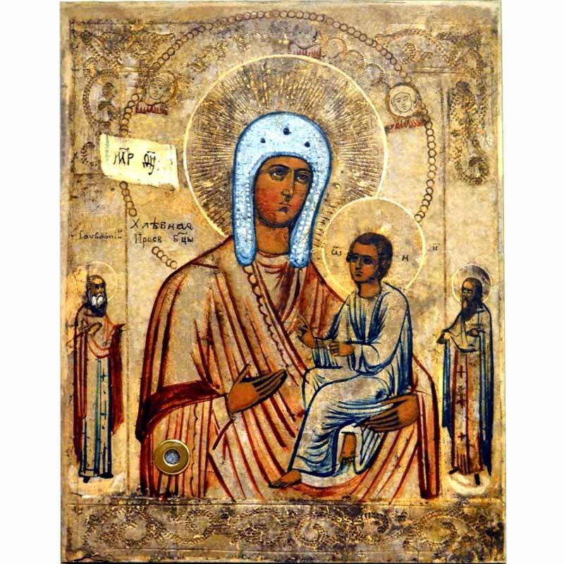 Хлебная (Запечная) икона Божьей Матери на дереве с мощевиком.