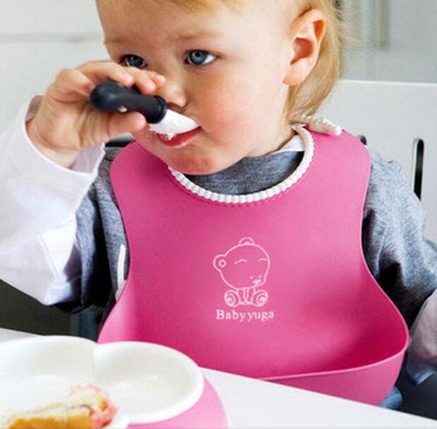 Нагрудник детский силиконовый с карманом Малиновый фото
