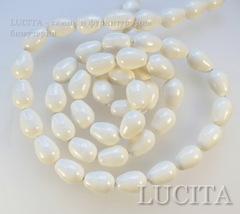 5821 Хрустальный жемчуг Сваровски Crystal Ivory грушевидный 11х8 мм