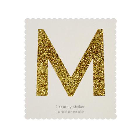 Стикер M, мерцающее золото