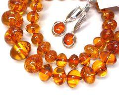 янтарные бусы оранжевого цвета