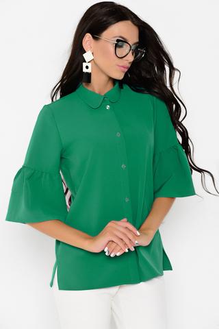 <p>Нарядная блузка прямого силуэта с воротником на стойке и планкой с пуговицами. Рукав 3/4 с воланом.</p>