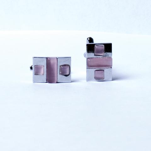 Запонки La madre белого металла c розовым камнем