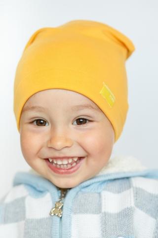 Детская шапка хлопковая гладкая тонкая желто-охристая