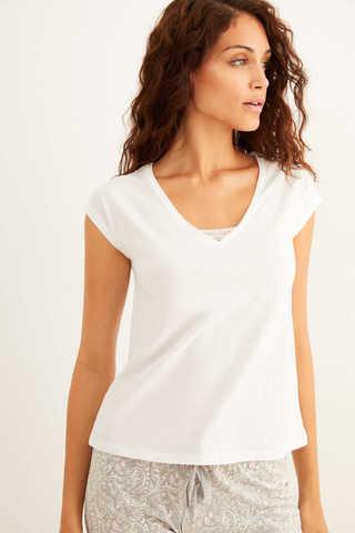 Біла бавовняна футболка з короткими рукавами і мереживом