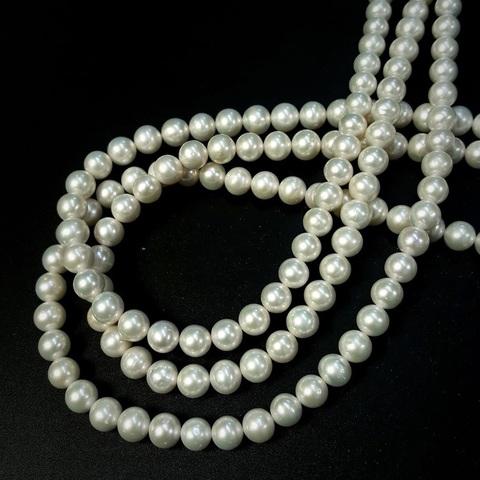 Жемчуг белый А+ натуральный шар 7,3-8,3 мм размер бусин увеличивается от концов нити к центру