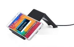 Универсальная беспроводная зарядка стандарта Qi для зарядки смартфонов и планшетов.