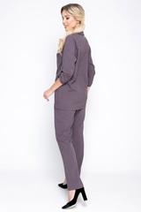 <p>Хит сезона! Деловой костюм модного кроя. Пиджак свободного силуэта. Рукав 3/4 с патой на пуговице.. Функциональные карманы. Без подклада. Застежка на пуговицу. Брюки прямые, с карманами, на резинке. Длины: Пиджак: 44-52р - 76-78см ; <span>Брюки во всех размерах 98 см по внешнему шву.</span></p>