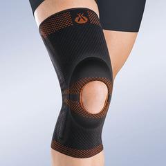 Бандаж коленный c открытой коленной чашечкой с силиконовой подушечкой и пружинными ребрами жесткости Orliman Rodisil
