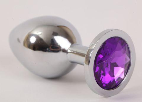 Серебристая анальная пробка с фиолетовым стразом - 8,2 см.
