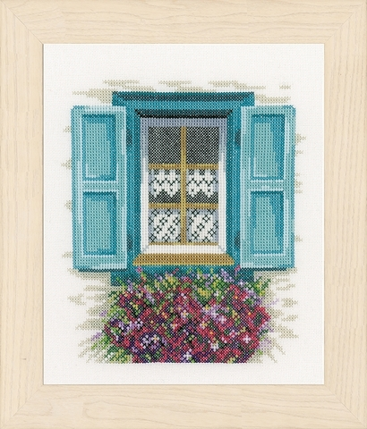Window with blue shutters