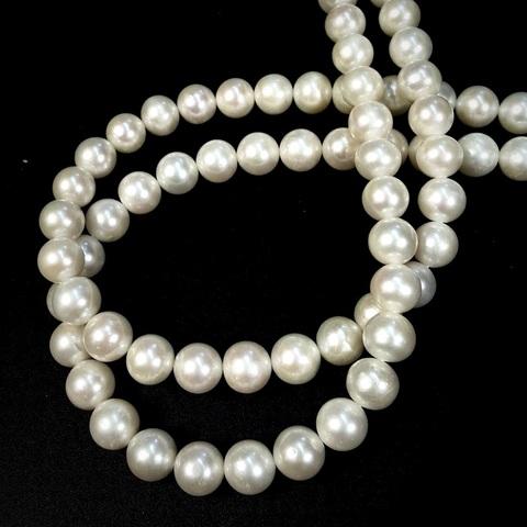 Жемчуг белый А натуральный 10,5-11 мм размер бусин увеличивается от концов нити к центру