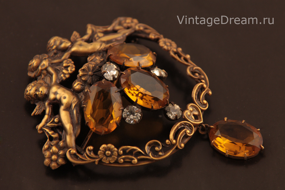 Exquisite brooch with cherubs by Joseff of Hollywood