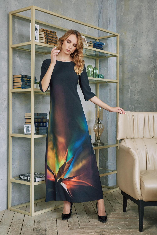 Платье З420-124 - Восхитительное длинное платье ультрамодного черного цвета с мягким цветовым переходом в ошеломительную цветовую абстракцию на подоле.А-образный силуэт платья – лиф облегает грудь, чем подчёркивает её красоту, а подол постепенно расширяется книзу. Таким образом, дает возможность обладательнице платья скрыть разные недостатки фигуры, к примеру, в области бёдер или талии.Особенно эффектно смотрится на высоких девушках. Вырез горловины в форме лодочки придает чувственности образу.Рукава три четверти добавляют облику шарма и очарования и подчеркивают изящество рук.Станьте еще прекраснее, надев это платье для особого случая