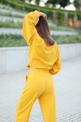 Спортивный костюм желтого цвета женский оптом