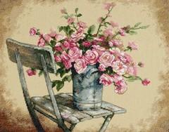 DIMENSIONS Розы на белом стуле (Roses on white chair)