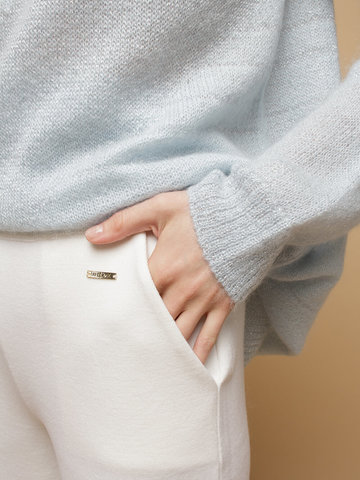 Женские брюки белого цвета из шерсти - фото 5