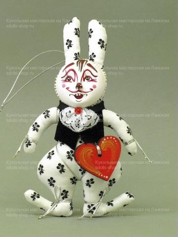 Кролик в жилете и манишке с аксессуаром