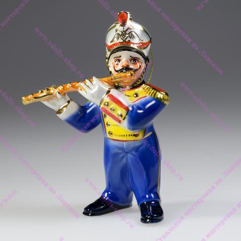 Музыкант с флейтой - фарфоровая игрушка