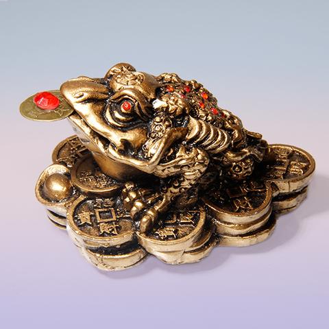 Трехпалая жаба на монетах - на богатство, под бронзу