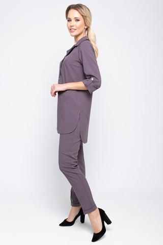 """<p>Костюм """"Твилла"""" шикарный офисный комплект для модницы! Прямые брюки на резинке отлично сочетаются с эффектной длинной туникой. Рукав 3/4 с """"патой"""".</p>"""