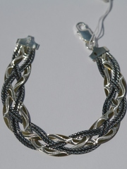 Коса четырехцветная с позолотой и чернением(серебряный браслет )