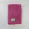 Вязаный плед из шерсти мериноса розовый