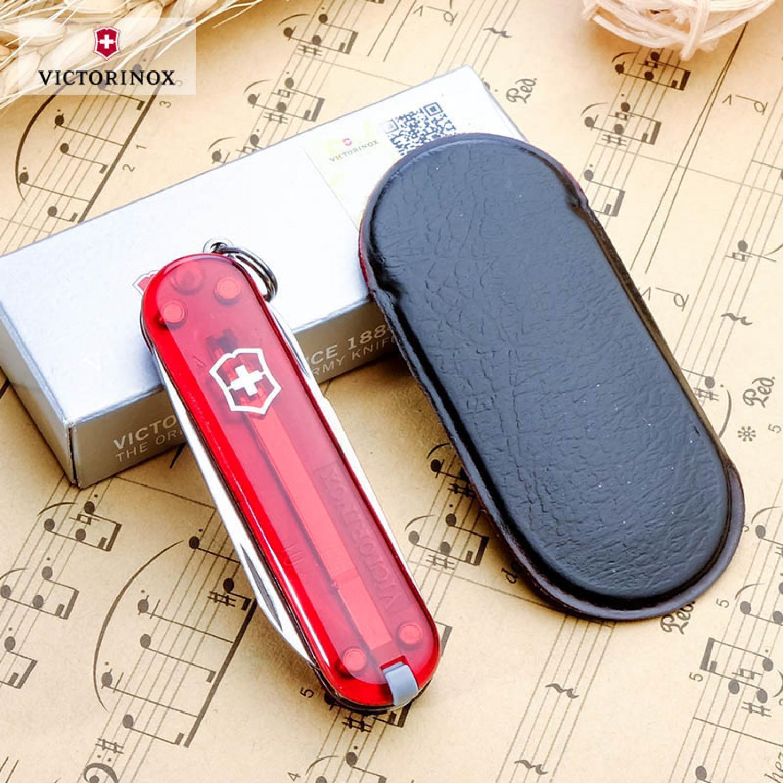 Нож-брелок Victorinox Classic (0.6223.T) 7 функций, 58 мм. в сложенном виде, цвет красный полупрозрачный | Wenger-Victorinox.Ru