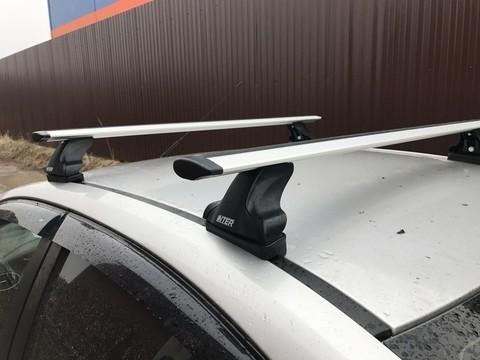 Багажник Интер на крышу Peugeot 307 2001-2008 в штатные места 8891 крыловидные дуги 120 см.