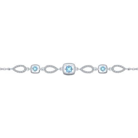 Браслет из серебра с голубыми топазами и фианитами