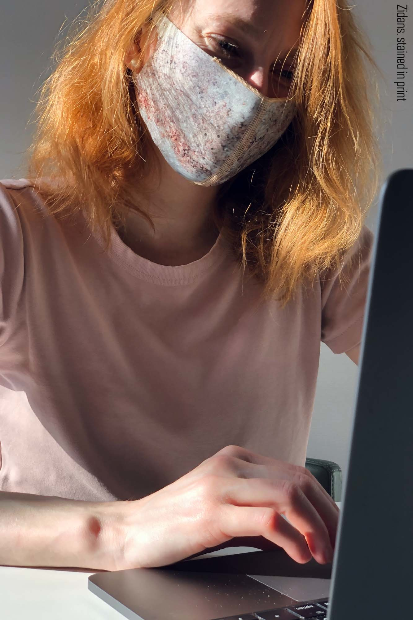 Reusable safety mask stained in print