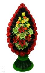 Венок украшенный цветами роз, гвоздики и лилии