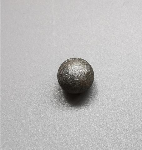 Шарик из метеорита Муонионалуста
