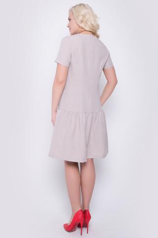 <p>Очаровательное платье свободного кроя с заниженной талией. По низу изделия волан на сборке. Рукав короткий. По спинке замок.(Длины: 44-92см; 46-93см; 48-94см; 50-95см)</p>